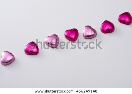 Side-by-side heart-shaped chocolate - stock photo