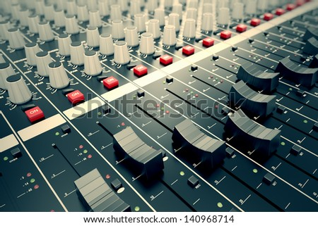 Side closeup on a sliders of a mixing console. It is used for audio signals modifications to achieve the desired output. Applied in recording studios, broadcasting, television and film post-production