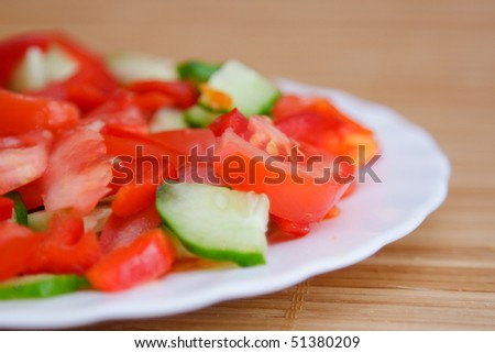Side dish with red tomato and green cucumber