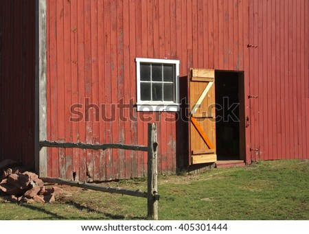 Side of a red barn on a farm in Connecticut. - stock photo