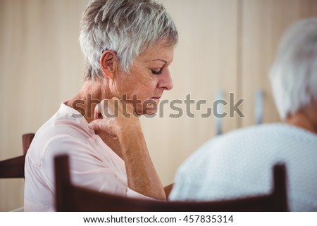 Side of a senior looking sad woman during the lunch