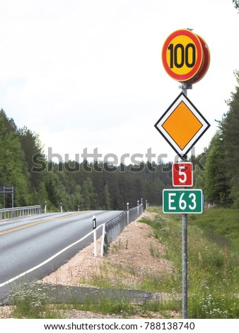 Side of deserted Finnish highway with colorful signs