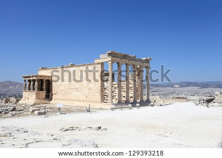 Side of Erechtheum greek temple at acropolis of Athens in summer, Greece