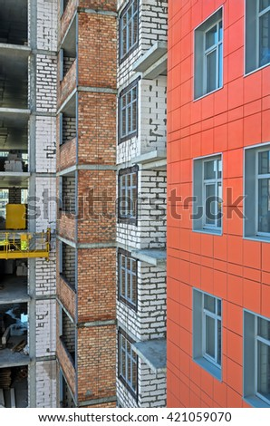 Side of of a house construction high-rise multilevel building with right angles closeup - stock photo