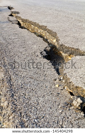 Side of the asphalt road surface crack due to ground collapsing  - stock photo