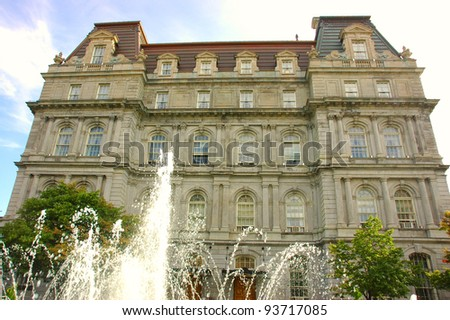 Side of the Montreal city Hall facing a fountain in old Montreal, Canada - stock photo