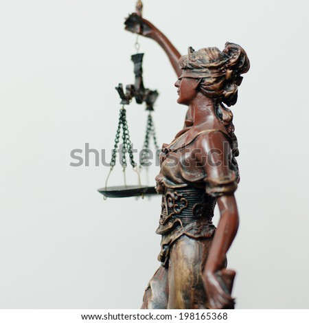 side of themis, femida or justice goddess sculpture with right hand holding scale on white copy space background picture - stock photo