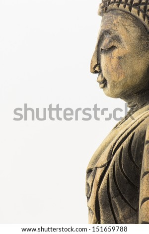 Side of wood buddha with eyes closed  isolated on white background,Thai style buddha made from wood - stock photo