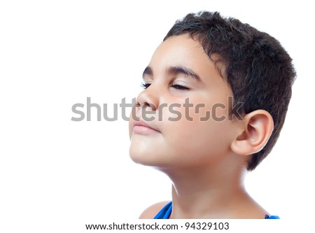 side portrait of a latin boy looking up isolated on white with space for text - stock photo