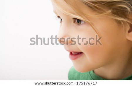 Side portrait of beautiful little girl