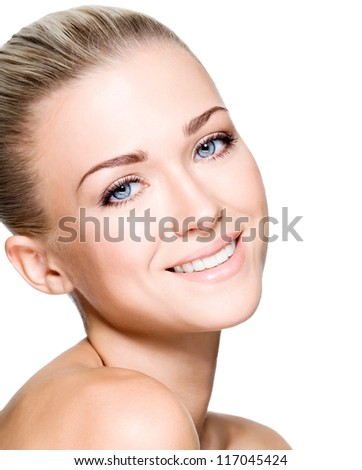 Side portrait of beautiful smiling woman with clean face - isolated on white - stock photo