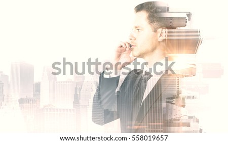 Side portrait of handsome businessman talking on phone. Abstract city background. Communication concept