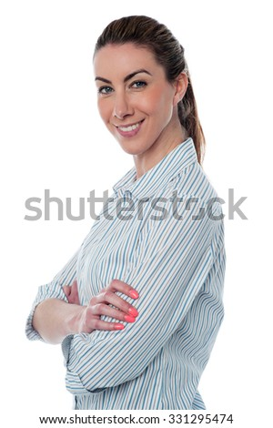 Side pose of a business lady, crossed arms.