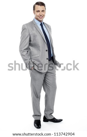 Side pose of casual business representative posing with hands in trousers pocket - stock photo