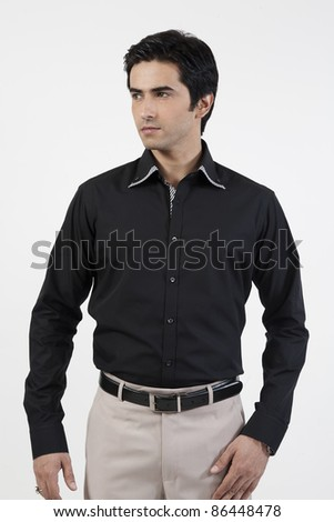 side pose or profile shot of a young handsome man, isolated on white