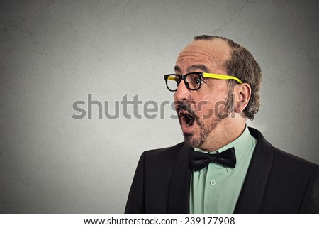 Side profile headshot surprise astonished man. Closeup portrait guy looking surprised in disbelief open mouth isolated grey background with copy space. Human emotion facial expression body language  - stock photo