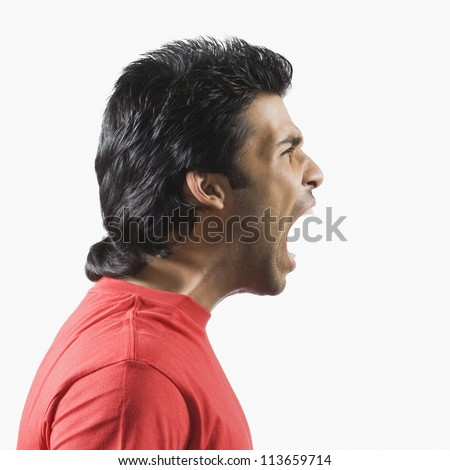 Side profile of a man shouting - stock photo