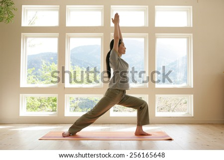 Side profile of a young woman practicing yoga - stock photo