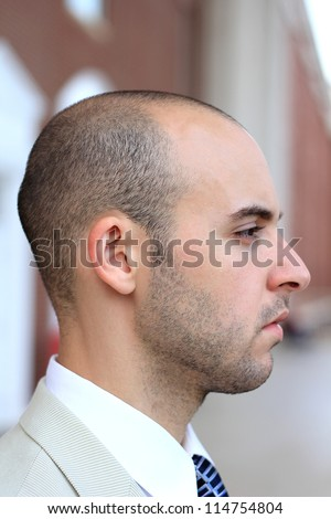 Side Profile of an Attractive, Young Professional Mature Businessman Man Thinking and Contemplating - stock photo