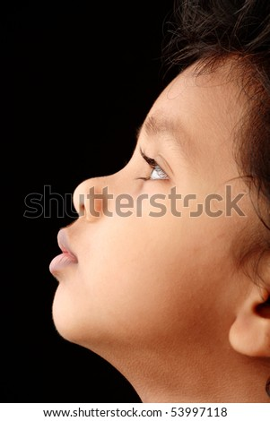 Side profile of an Indian Kid - stock photo