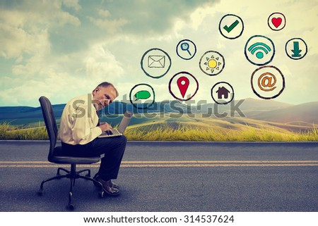 Side profile senior elderly man executive working on computer using social media application traveling   - stock photo