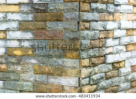 SIDE SQUARE STAINED BRICKS WALL OF PRIVATE HOUSE