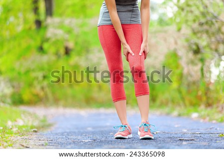 Side stitch - woman runner side cramps after running. Jogging woman with stomach side pain after jogging work out. Female athlete. - stock photo