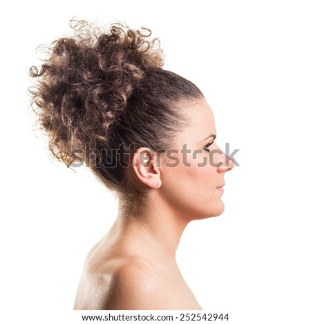 Side studio shot of a beautiful young woman with highly raised curly hair isolated on white background - stock photo