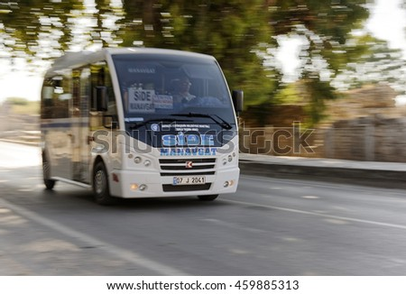 SIDE, TURKEY - JULY 7, 2016: The popular public vehicle of transport is called 'dolmus' at the antic old town on July 7, 2016 in Side, Turkey.