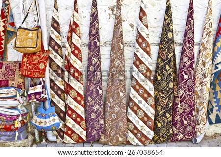 SIDE, TURKEY - MARCH 9, 2015: Carpet goods street display at a shop in the old town. - stock photo