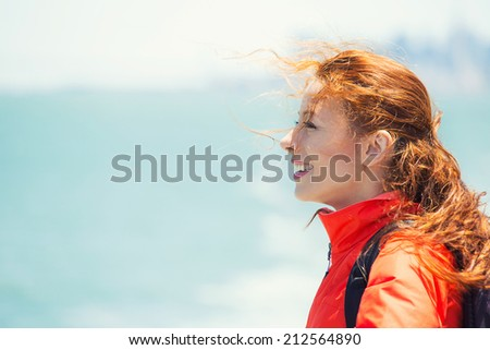 Side view closeup portrait, headshot beautiful young Woman relaxing on boat enjoying summer freedom with hair in the wind looking at ocean. Attractive girl on summer travel holidays vacation outside. - stock photo