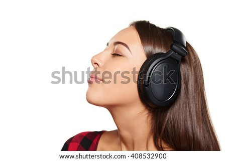 Side view closeup portrait of young female listening enjoying music in headphones with closed eyes, over white background - stock photo