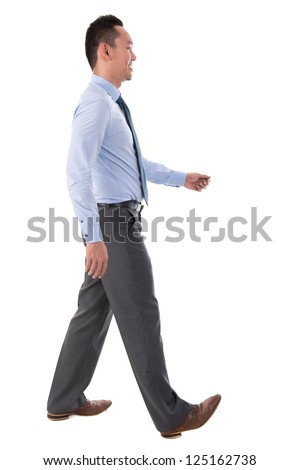 Side view full body Chinese Asian male walking looking forward isolated on white background - stock photo