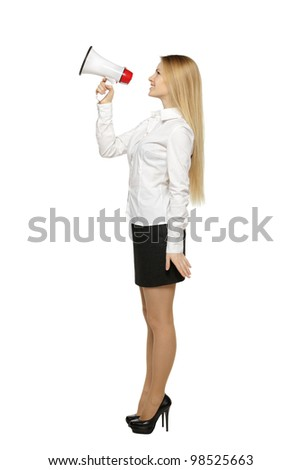 Side view full length of young business woman with megaphone, over white background