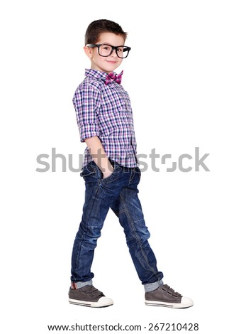 side view full length portrait of a stylish boy - stock photo