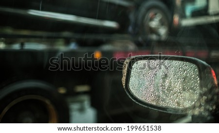 Side View Mirror on Rainy Day - stock photo