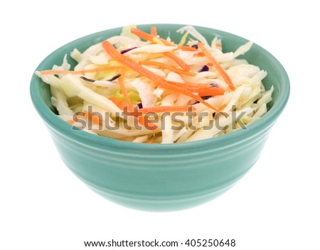 Side view of a bowl filled with coleslaw isolated on a white background. - stock photo