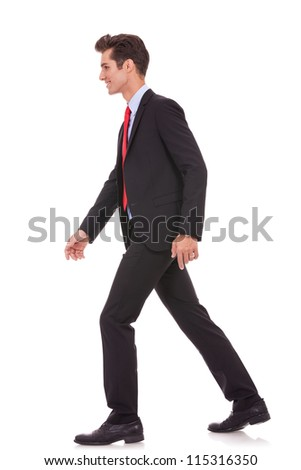 side view of a business walking forward, on white background - stock photo