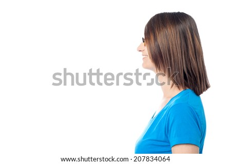 Side view of a casual woman smiling, isolated on white - stock photo