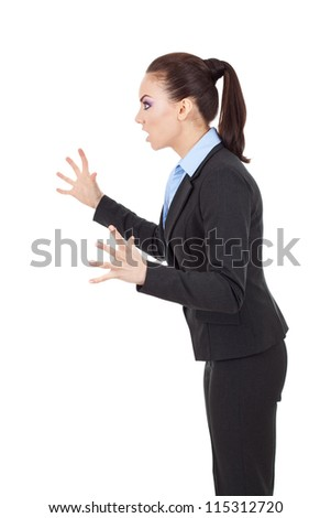 side view of a fierce business woman scaring someone - stock photo