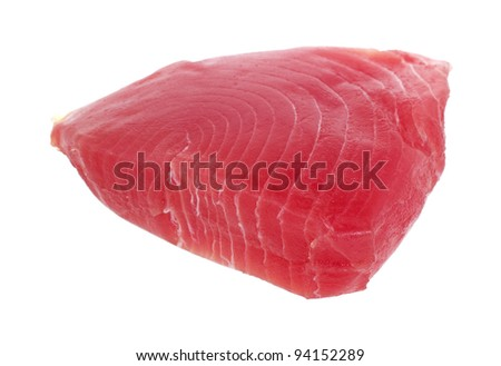 Side view of a fresh yellowfin tuna steak on a white background. - stock photo