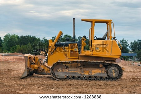 Side view of a front end loader - stock photo
