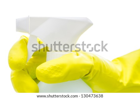 Side view of a hand in a yellow rubber glove holding a spray bottle. Isolated over white background. - stock photo