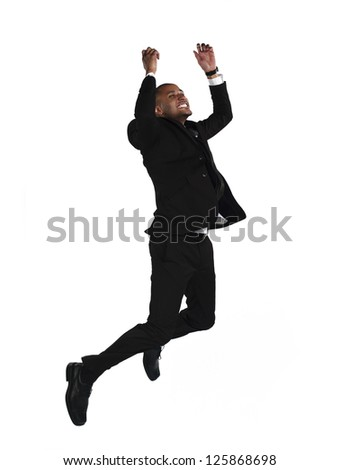 Side view of a happy businessman with clenched fist over white background - stock photo