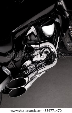 Side view of a harley style chopper motorcycle with shiny chrome parts - stock photo