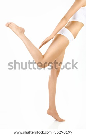 Side view of a harmonous female body in a pose, isolated - stock photo