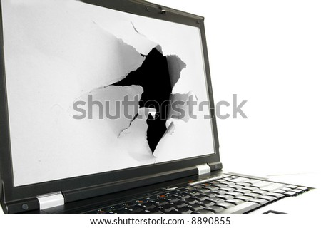 Side view of a laptop screen with a torn hole - stock photo