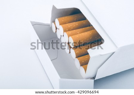 Side view of a pack of cigarettes - Plain tobacco packaging - stock photo