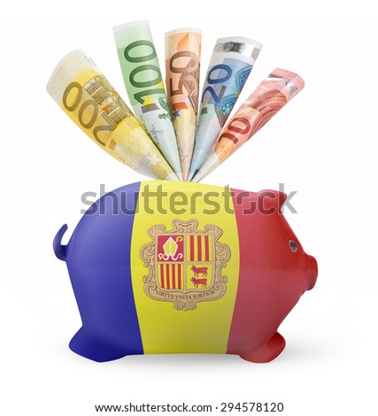 Side view of a piggy bank with the flag design of Andorra and various european banknotes.(series) - stock photo