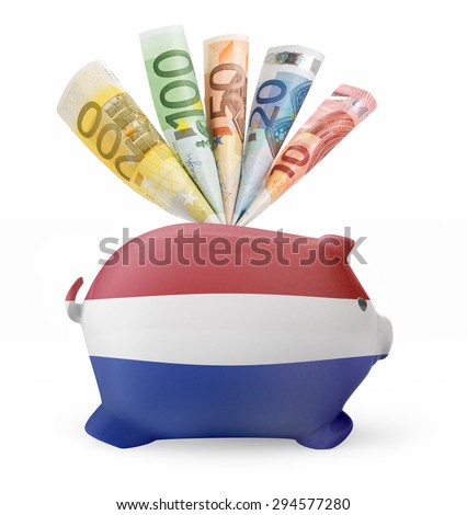 Side view of a piggy bank with the flag design of Netherlands and various european banknotes.(series) - stock photo